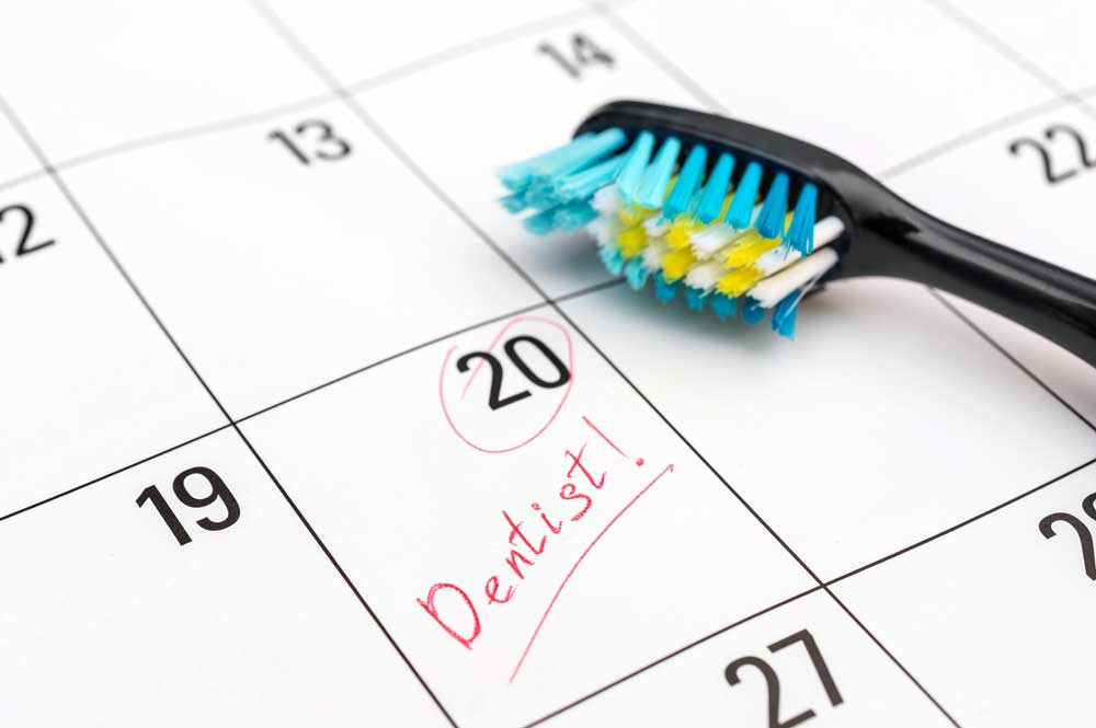 picture of a calendar with dental appointment